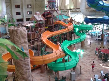 theres a giant climbing structure with nets ramps tunnels water cannon turrets and so on topped by the now mandatory 1000 gallon bucket